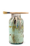 Old container with paint and brush on white background Stock Photos