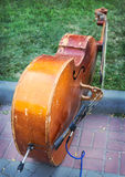 Old contrabass on sidewalk Stock Image