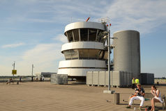 Old Control Tower on top of Observation Deck. A security officer at the observation deck by the Dusseldorf Airport control tower Royalty Free Stock Photo