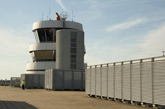 Old Control Tower on top of Observation Deck. A security officer at the observation deck by the Dusseldorf Airport control tower Stock Photo