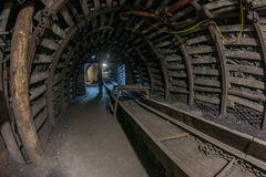 Old conveyor in underground mine Stock Photography