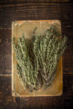 Old cook book with thyme on the wooden table vertical Stock Images