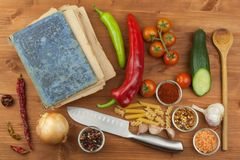 Old cookbook recipes on a wooden table. Cook healthy vegetable. Preparation of home diet food. Stock Photography