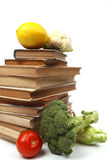 Old cookbooks with several vegetables Royalty Free Stock Photo