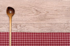 Old cooking spoon on wooden board Royalty Free Stock Image
