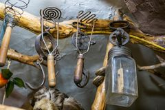 Old cooking utensils. Old tableware utensils of copper and tin on a trolley, pots, jugs Stock Image
