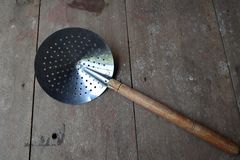 Old cookware. On wooden background stock image