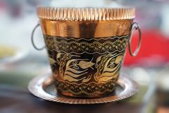 Old copper bucket with handle on blur background royalty free stock photos