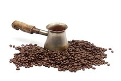 Old copper coffee pot with coffee beans Stock Photography