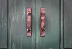 Old copper door knob. On wooden door royalty free stock photography