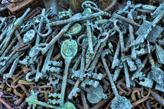Old copper keys. Old oxidized copper keys in a junk shop Stock Photography