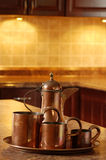 Old copper in kitchen focus on jug Stock Photo