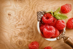 Old copper ladle filled with ripe raspberries Royalty Free Stock Photography