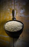 Old copper ladle filled with sesame Royalty Free Stock Image