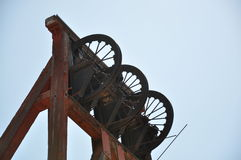 Old copper mining machinery, Arizona. The upper mechanisms of old copper mining machinery from an antiquated copper mine set against the blue Arizona sky royalty free stock photo