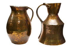 Old copper pitchers Stock Photography