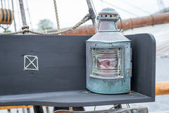 Old copper sailing boat's lamp. On the bench on yacht Royalty Free Stock Photos