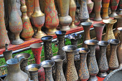 Old copper vases in the street market of Baku Stock Photo