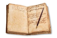 Old copybook with nib. Isolated on white background Royalty Free Stock Image