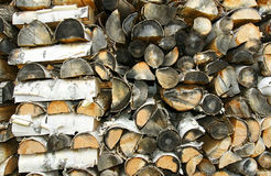 Old cord of paper birch firewood close up Royalty Free Stock Image