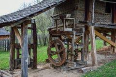 Old corn mill. Old wooden mill, Village Museum, Valcea, Romania Stock Photography