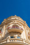 Old corner building with stone balconies against a sky Royalty Free Stock Image
