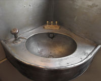 Old corner single metal sink. Royalty Free Stock Photography