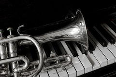 Old cornet. On a piano keyboard Royalty Free Stock Photo
