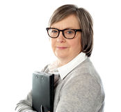 Old corporate lady holding business document Stock Photo