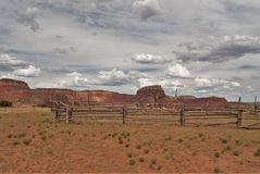 Ghost Ranch Corral. An old corral sits empty among the remote desert landscape of Ghost Ranch in northern New Mexico near Abiquiu Royalty Free Stock Photo