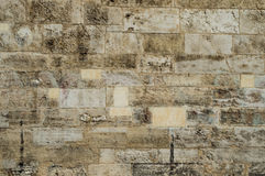 Old corroded running bond stone wall background Royalty Free Stock Images