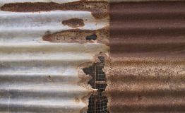 Old corrugated iron fence. For background Royalty Free Stock Photo