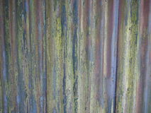 Old corrugated iron fence. With colorful veneer stock photos