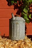 Old metal gas can with a spout. An old corrugated metal can with a spout used to transport fluids, especially oil and gasoline stock images