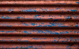 Old corrugated panel with flaky paint Stock Photography