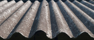 Old corrugated slate. Close-up of an old corrugated slate rooftop Royalty Free Stock Image