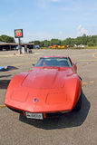 Old corvette at airport with historic license plate Great Barrin Stock Image