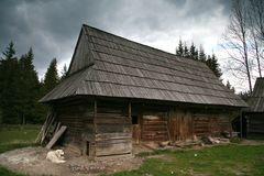 Old cotage. Old hut in country landscape Royalty Free Stock Photo