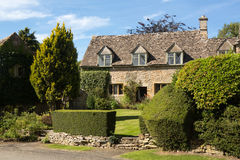 Old cotswold stone house in Icomb. Ancient cotswold stone house and flower garden in Cotswolds village of Icomb Stock Photos