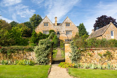 Old cotswold stone house in Ilmington. Ancient cotswold stone house and flower garden in Cotswold village of Ilmington Royalty Free Stock Photo