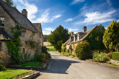 Old cotswold stone houses in Icomb. Ancient cotswold stone houses and flower garden in Cotswolds village of Icomb Royalty Free Stock Photo