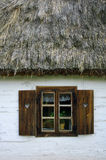 Old cottage. With thatched roof royalty free stock photo