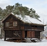 Old cottage. Old wooden stabbur; combined storage and living quarters Royalty Free Stock Images