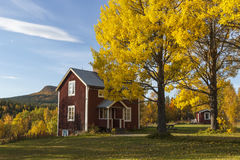 Old cottage in autumn colors Stock Images