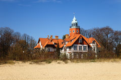 Old cottage on the beach Stock Photography