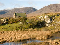 Old cottage at a creek in Ireland Royalty Free Stock Images