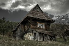Old cottage and dark clouds. Old cottage in village Velke Borove and dark clouds over, Slovakia stock images