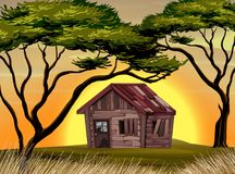 Old cottage in the field at sunset. Illustration Stock Images
