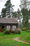 Old cottage in the woods. The picture of an old cottage in the forest, Latvia Royalty Free Stock Photography