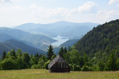 National park Tara in Serbia. Old cottage in the green field Stock Photography
